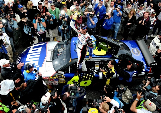 Jimmie Johnson, driver of the #48 Lowe's Chevrolet, celebrates in victory lane after winning the NASCAR Sprint Cup Series Goody's Fast Pain Relief 500 at the Martinsville Speedway on March 29, 2009 in Martinsville, Virginia.  (Photo by Nick Laham/Getty Images)