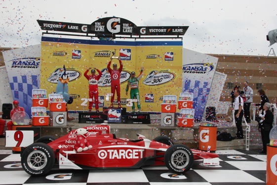 Scott Dixon on the podium at Kansas with Helio Castronevas and Tony Kanaan. (IndyCar photo by Chris Jones)