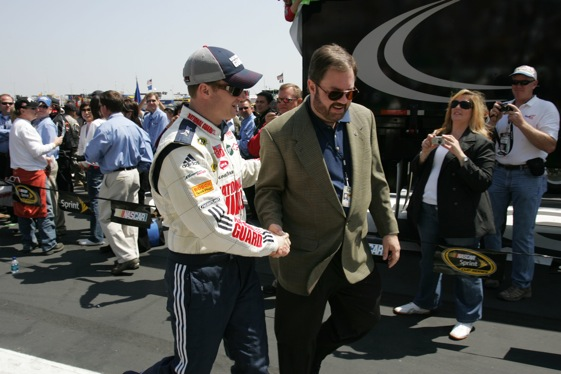 exas Motor Speedway President Eddie Gossage shakes hand with Dale Earnhardt Jr. before the Samsung 500 at Texas Motor Speedway. (Getty Images for Texas Motor Speedway)