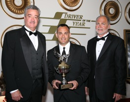 Top Fuel driver Tony Schumacaher received his 2008 Driver of the Year Award during ceremonies at the Motorsports Hall of Fame in Talladega last week. With Schumacher, are NHRA president Tom Compton and DOTY president Barry Schmoyer.