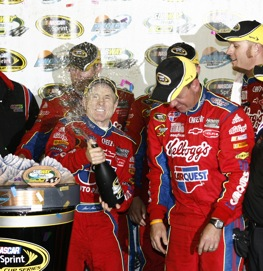 Mark Martin dispenses some bubbly after winning in Phoenix. (RacinToday photo by David Vaughn)