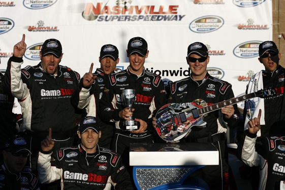 Joey Logano and his crew celebrate in Victory Lane at Nashville after a much-needed win. (RacinToday.com photo by David Vaughn)