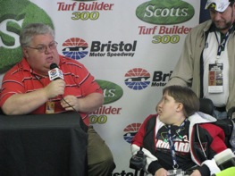 Sportswriter David Poole talks during a news conference in March at Bristol Motor Speedway where he helped create awaremess for Pennies for Wessa as Wessa Miller and her father, Booker, look on. Wessa gave Dale Earnhardt a penny before the 1998 Daytona 500, Earnhardt's one and only win in the Great American Race. (Photo Credit: NASCAR Public Relations)
