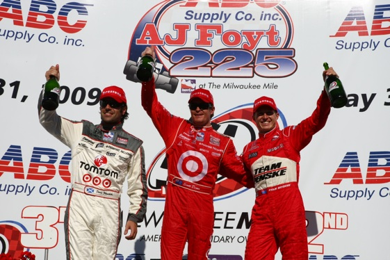From left - Dario Franchitti, Scott Dixon and Ryan Briscoe celebrate at Milwaukee. (IndyCar photo by Dan Helrigel)