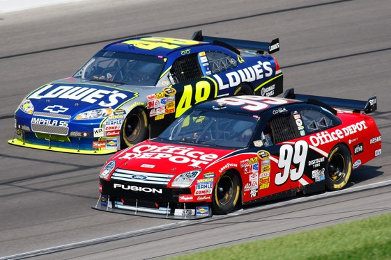 Remember this classic battle between Carl Edwards and Jimmie Johnson at Kansas last fall? Edwards says the sport needs more of these. (Photo by John Harrelson/Getty Images for NASCAR)