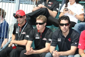 Helio Castroneves and Ryan Briscoe of Team Penske sit next to Dario Franchitti of the arch-rival Target Chip Ganassi Racing team during Saturday's drivers meeting at Indy. (Indianapolis Motor Speedway photo by Jim Haines)