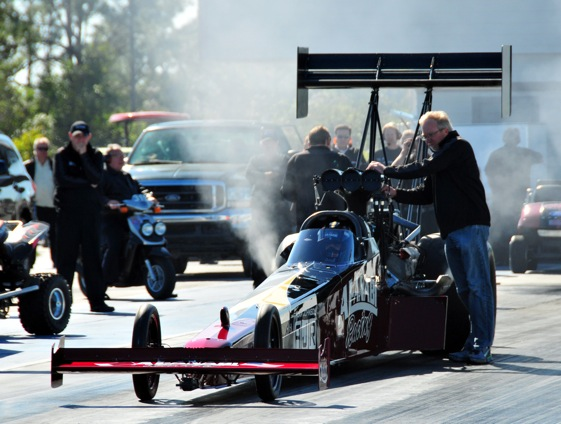 Alan Johnson readies Top Fuel driver Larry Dixon for a test run. (Photo courtesy of Al-Anabi Racing)
