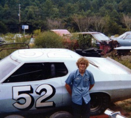 Chuck Buchanon, track chaser. Here, he poses outside Bill Elliott&#039;s old race shop with the car Elliott used to win Darlington in 19??.