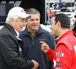 Helio Castroneves talks with owner Roger Penske and former teammate Gil deFerran during pole day at Indy. Castroneves won the pole, edging current teammate, Ryan Briscoe.