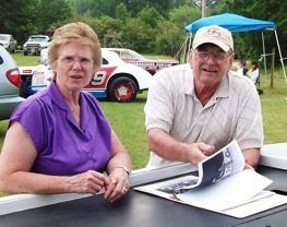Racing historian Martha Daniel and former racer Roscoe Smth poured over old photos down on the farm. (RacinToday photo by Stephanie Minter)