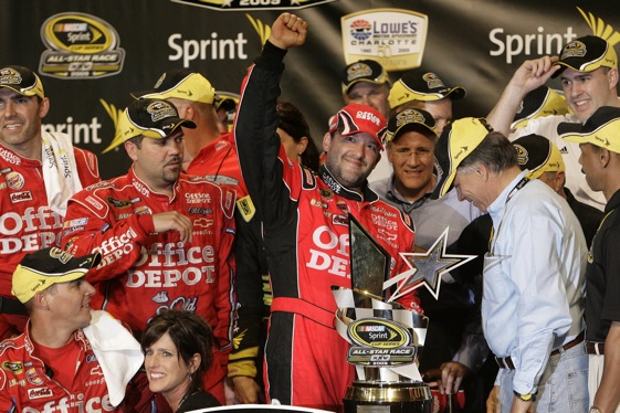 Tony Stewart and his team celebrate their Sprint All-Star Race. (RacinToday photo by Garry Eller)