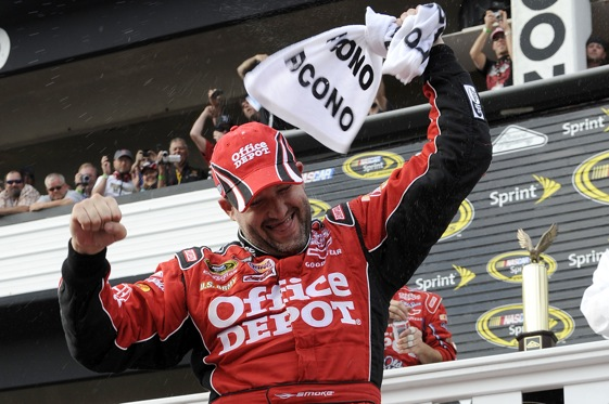 Tony Stewart celebrates in Victory Lane after winning  the NASCAR Sprint Cup Series Pocono 500 (Photo by John Harrelson/Getty Images for NASCAR)