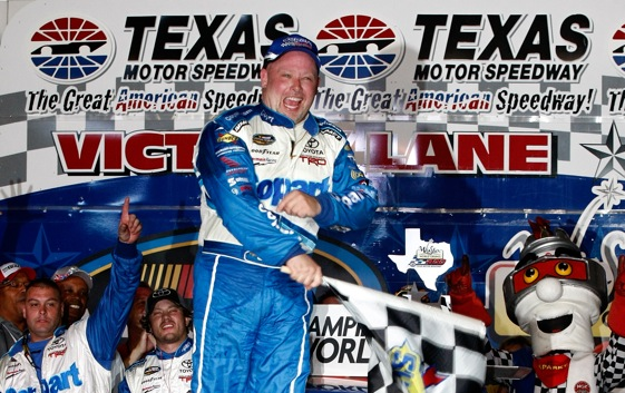 Todd Bodine celebrates in victory lane after winning the Winstar World Casino 400 in Texas. (Photo by Jonathan Ferrey/Getty Images)