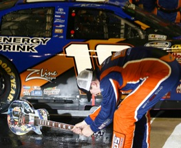 Kyle Busch prepares to alter his Nashville trophy so that his team members can enjoy it too.. (RacinToday photo by David Vaughn)
