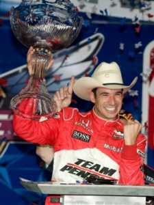 Helio Castroneves got to hoist the six-gun and the trophy at Texas Saturday night. (RacinToday photo by Owen Richards)
