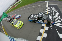 Brian Ickler takes the green flat at the Michigan 200 Camping World Trucks Series race, but it was Colin Braun who took the checkered flag. (Photo by Chris Trotman/Getty Images)
