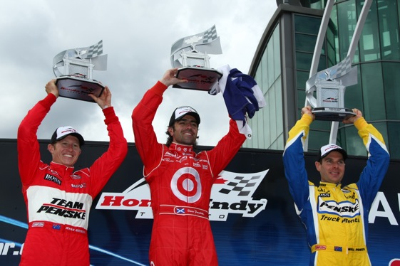 Race winner Dario Franchitti, center, is flanked by Ryan Briscoe (left) and Will Power (right). (IndyCar photo by Jim Haines)