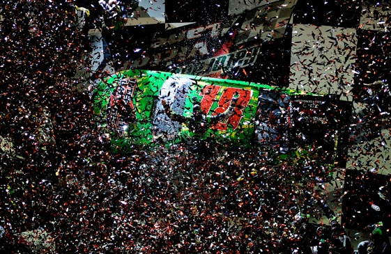 Kyle Busch was buried by a blizzard of confetti after winning the Coke Zero in 2008. Confetti blizzards will be the only blizzards occurring at Daytona Beach tonight. (Photo by Rusty Jarrett/Getty Images for NASCAR)