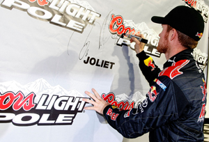 Brian Vickers signs the wall in victory lane after qualifying for the pole.  (Photo by Jason Smith/Getty Images for NASCAR)