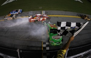 Kyle Busch's car slides across the finish line sideways at the end of Saturday night's race. (Photo by Streeter Lecka/Getty Images)