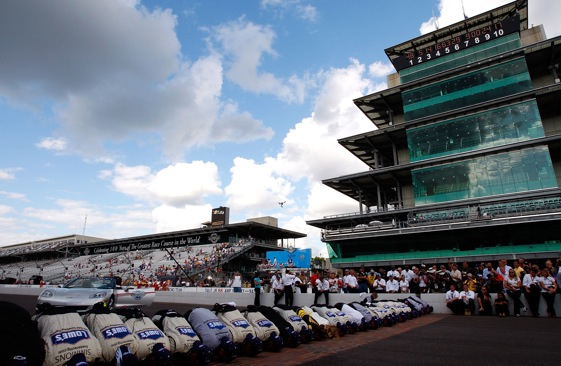 Jimmie Johnson and his Hendrick Motorsports team plant big wet ones on the bricks at Indianapolis Motor Speedway.  (Photo by Geoff Burke/Getty Images for NASCAR)