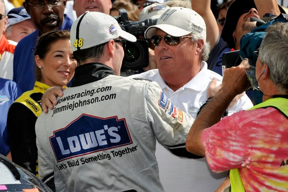 Miss Sprint makes an appearance in Victory Lane at Indianapolis after Jimmie Johnson's win in the Brickyard 400.
