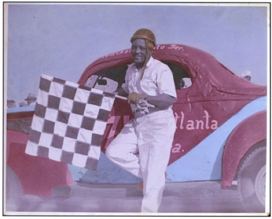 Ben Muckle took the checkered flag in Georgia race circa 1950. (Photo courtesy the Muckle famil collection)