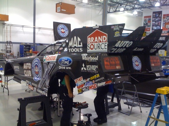 The crew of Robert Hight's Top Fuel car had their heads in the game as they prepared for this weekend's race at Maple Grove Raceway.