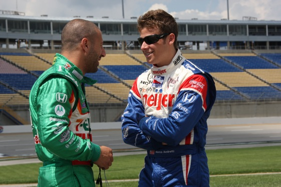 Tony Kanaan was back in a driver's suit at Kentucky on Friday, and talking to teammage Marco Andretti. Kanaan was injured in the last race when fuel ignited in his car. (IndyCar Series photo by Chris Jones)