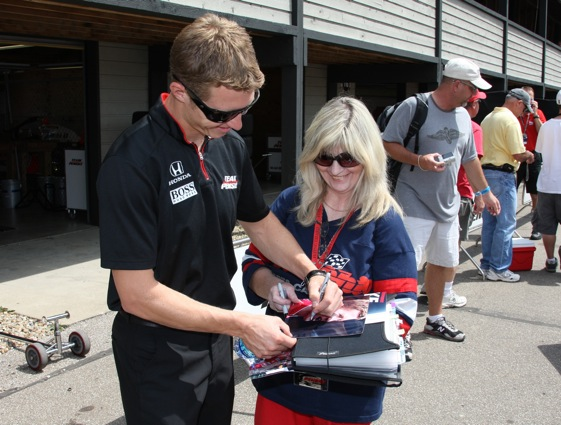 Ryan Briscoe signed autographs at Mid-Ohio and then went out and won the pole for Sunday's race.