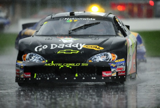 Ron Fellows is always ready to lend his skills for a NASCAR team, no matter the weather.  (Photo by Robert Laberge/Getty Images for NASCAR)