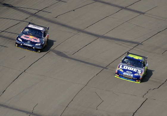 Brian Vickers heads toward Victory Lane while Jimmie Johnson heads toward the pits for fuel. (Photo by Harry How/Getty Images)