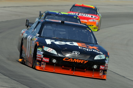 Denny Hamlin ran away late to win the rain-delayed Sprint Cup race at Pocono Raceway on Monday. (Photo by Doug Pensinger/Getty Images)