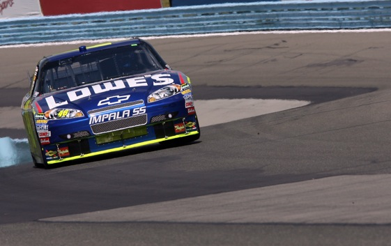 Jimmie  Johnson moves through turns during Friday's practice at Watkins Glen. Johnson won the pole for Sunday's race. (Photo by Elsa/Getty Images)