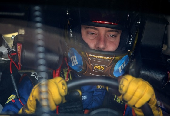 Kyle Busch is all business behind the wheel but can be a delightful dinner guest. (Photo by Nick Laham/Getty Images)