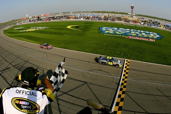 Jimmie Johnson beat Carl Edwards to the finish line at Kansas last year, but not before Edwards put a bonsai move on Johnson in Turn Four. (Photo by Matthew Stockman/Getty Images)
