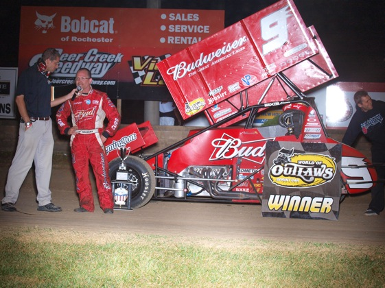 Joey Saldana gives an interview in the winner's circle. (World of Outlaws photo by Jason Durst)