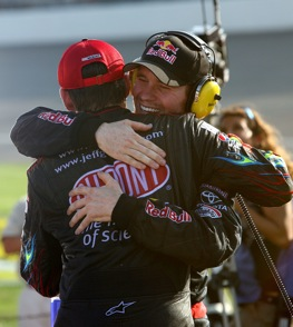Brian Vickers got a hug from former teammate Jeff Gordon after Vickers' victory at Michigan last month. (Photo by Jerry Markland/Getty Images for NASCAR)
