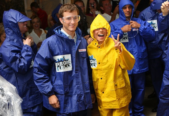 Kelly Ripa poses for a photo with NASCAR Sprint Cup Series driver Kasey Kahne prior to taking part in Largest Custard Pie fight during Guinness World Record Breaker Week on 'LIVE! with Regis and Kelly' during Chase Media Day on Thursday in New York City. (Photo by Mike Stobe/Getty Images for NASCAR)