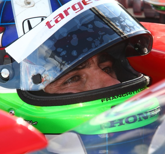 Dario Franchitti wins the IndyCar Series race and the championship on Saturday.