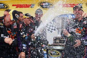Denny Hamlin sends his team to the showers after winning the Tums Fast Relief 500 at Martinsville on Sunday. (Photo courtesy of NASCAR)