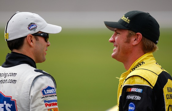 Jimmie Johnson and Clint Bowyer found something at Kansas Speedway amusing on Friday. (Photo courtesy of NASCAR)