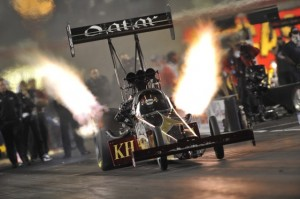 Larry Dixon lights up the night during qualifying at Las Vegas on Friday. (Photo courtesy the NHRA)
