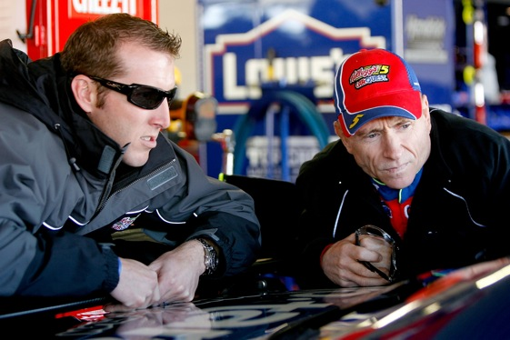 Driver Mark Martin and crew chief Alan Gustafson look over their Sprint Cup car at Kansas. Was it barely legal again?  (Photo by Matthew Stockman/Getty Images)