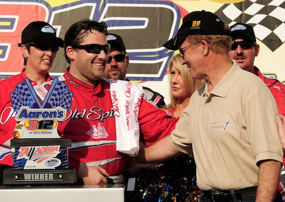 Morgan Shepherd arrived in Victory Lane at Talladega last year to congratulate friend and benefactor, Tony Stewart. (Photo by Rusty Jarrett/Getty Images for NASCAR)