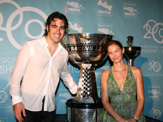 Dario Franchitti, wife Ashley Judd and the newest addition to their silverware collection. (Photo courtesy of the IndyCar Series)