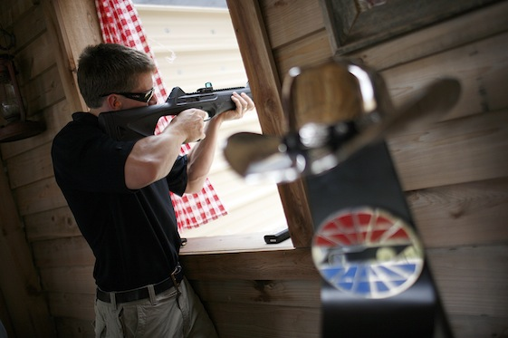 Carl Edwards takes aim during a shooting match with Texas Motor Speedway president Eddie Gossage. (Getty Images/Tom Pennington)