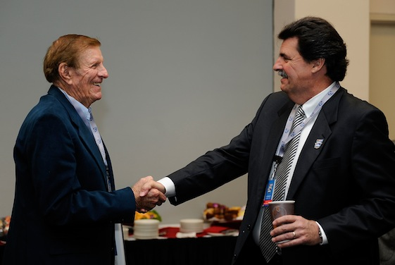 Former car owner and Hall of Fame nominee Bud Moore shakes hands with NASCAR president Mike Helton during voting day at the Hall of Fame. (Photo by Rusty Jarrett/Getty Images for NASCAR)