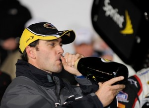 Jimmie Johnson enjoys a bit of post-race refreshment after winning Saturday night's race at Lowe's Motor Speedway. (Photo by Rusty Jarrett/Getty Images for NASCAR)