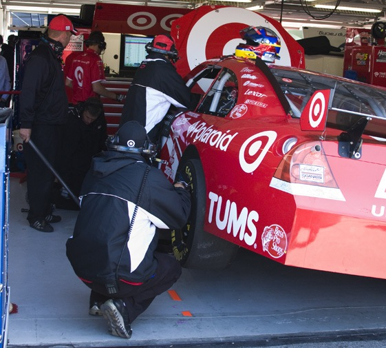 The crew of Juan Pablo Montoya puts final touches on their car in garages at Kansas Speedway, site of today's Price Choper 400. (RacinToday photo by Tony Bush)